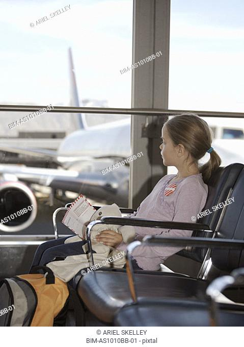 Girl sitting in airport terminal