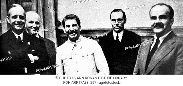 Photographic print of Joachim von Ribbentrop (1893-1946), Joseph Stalin (1878-1953), and Vyacheslav Molotov (1890-1986) meeting to sign the German-Soviet Pact...