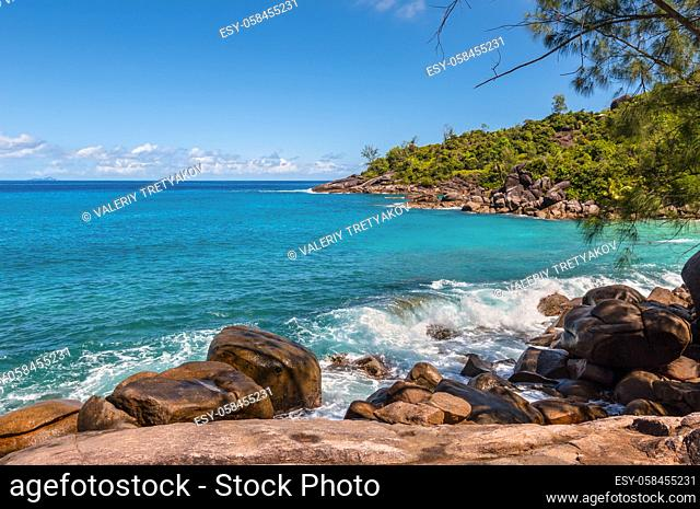 View from Anse Major Nature Trail over the northwest coastline of Mahe island and granite rock in the foreground, Seychelles
