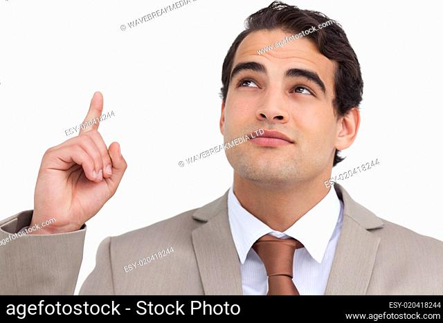 Close up of salesman looking and pointing up