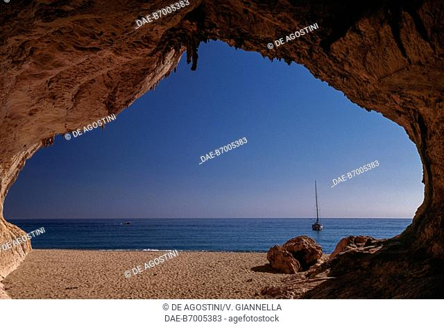 View from inside a cave on the beach of Cala Luna, National Park of the Bay of Orosei and Gennargentu, Ogliastra, Sardinia, Italy