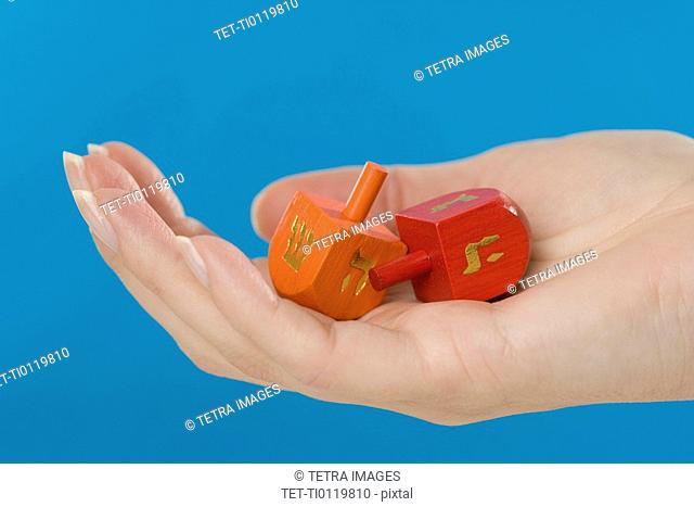 Hand holding Jewish Dradles