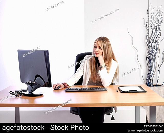 Young business woman at her workplace
