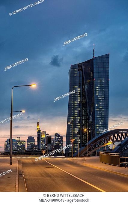 Germany, Hesse, Frankfurt am Main, European central bank with skyline and east harbour bridge at dusk