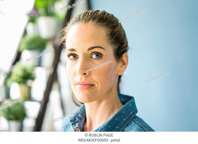 Portrait of a beautiful woman, looking at camera