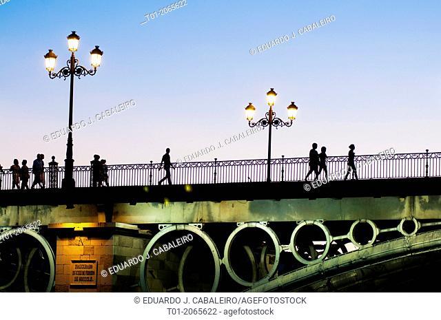 Triana bridge at night. Seville. Andalucia. Spain