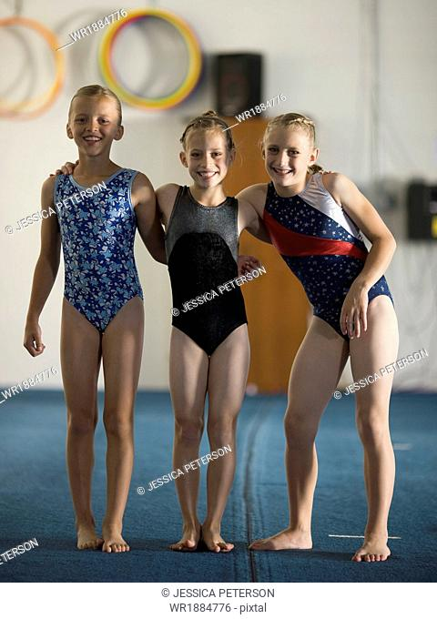 USA, Utah, Orem, portrait of girl gymnasts (8-11) in gym