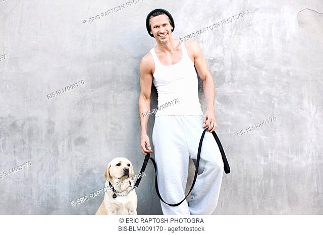 Caucasian man standing with dog
