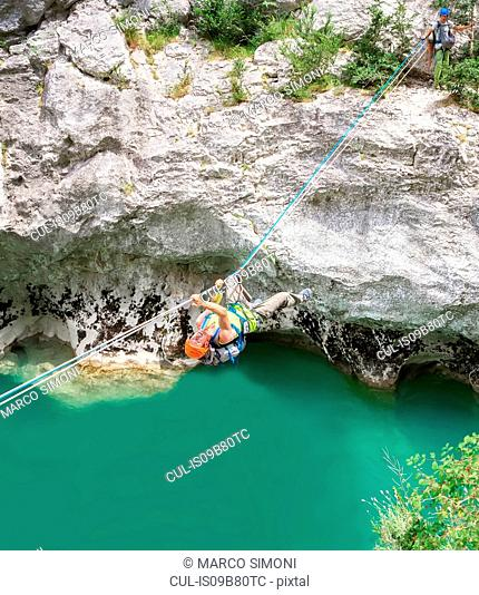 Man crossing Verdon gorge on rope, Sainte-Croix-du-Verdon, Provence-Alpes-Cote d'Azur, France, Europe