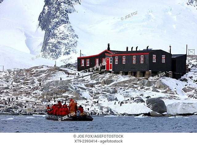 tourist zodiac approaches bransfield house port lockroy british antarctic heritage trust station on goudier island Antarctica