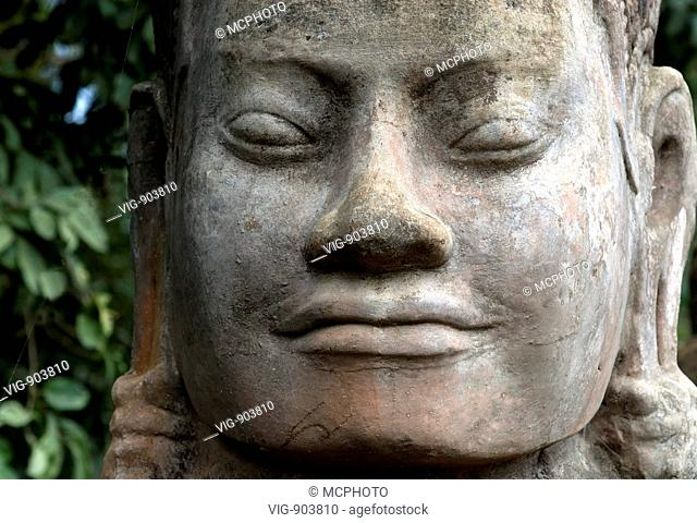 This stock photo shows a close up of a temple stone sculpture at the famous Angkor Wat Temple near Siam Reap in Cambodia