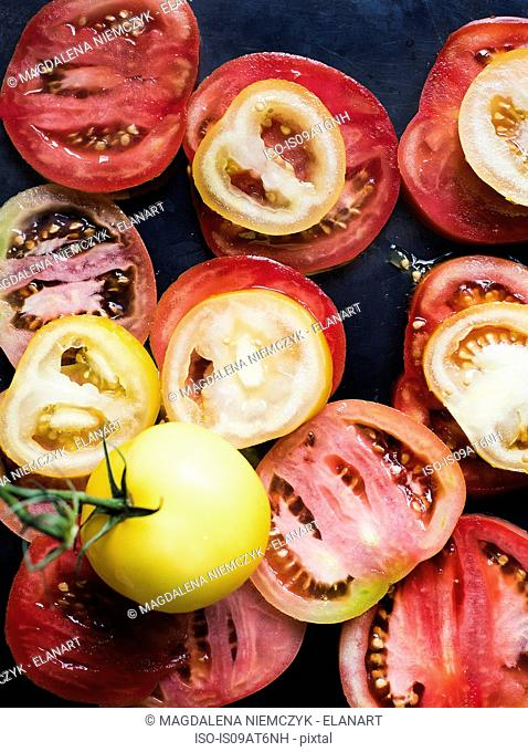 Still life of red and yellow sliced tomatoes
