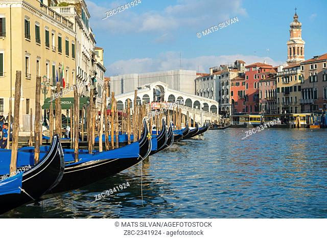 Buildings and Gondola on Grand canal and Rialto bridge in a sunny day in Venice, Italy