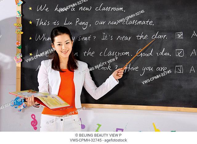 Young teacher teaching in class