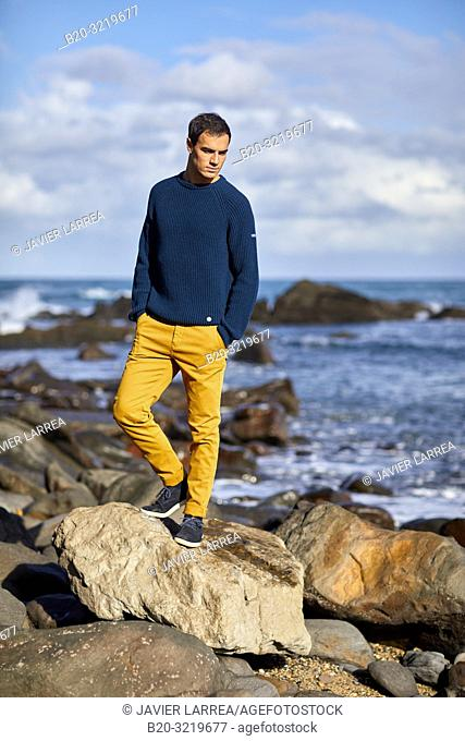 Young man, Beach, Mutriku, Gipuzkoa, Basque Country, Spain