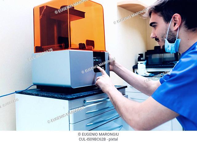 Male dentist using 3D printer