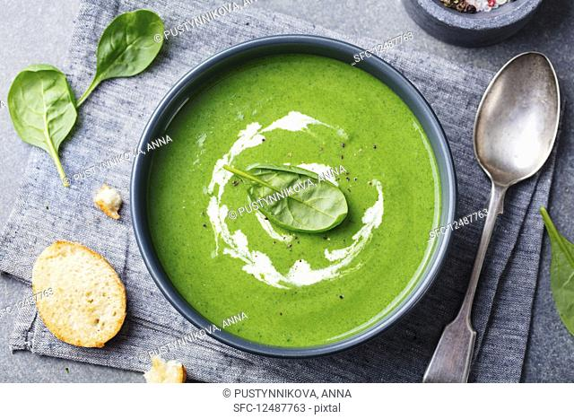 Spinach soup with cream in a bowl