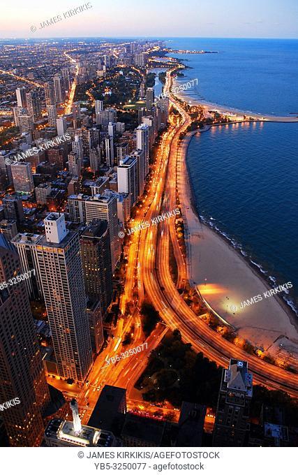 Traffic illuminates Lake Shore Drive in Chicago at dusk