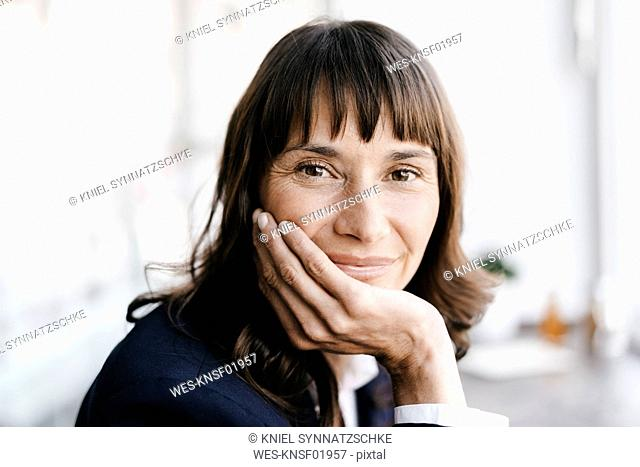 Businesswoman in cafe, smiling