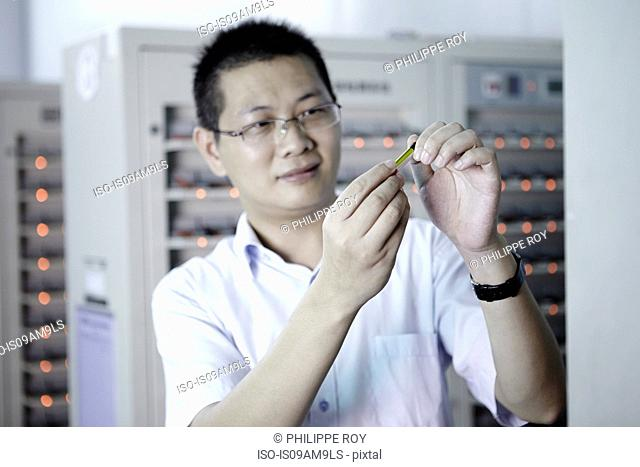 Worker looking at product in ecigarette factory