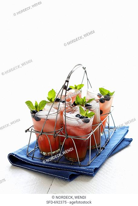 Glasses of Blueberry Lemonade in a Wire Drink Carrier, On a Blue Dish Cloth