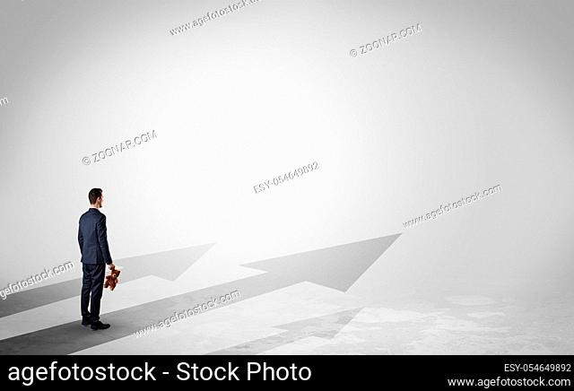 Man with object in his hand on the direct way to success