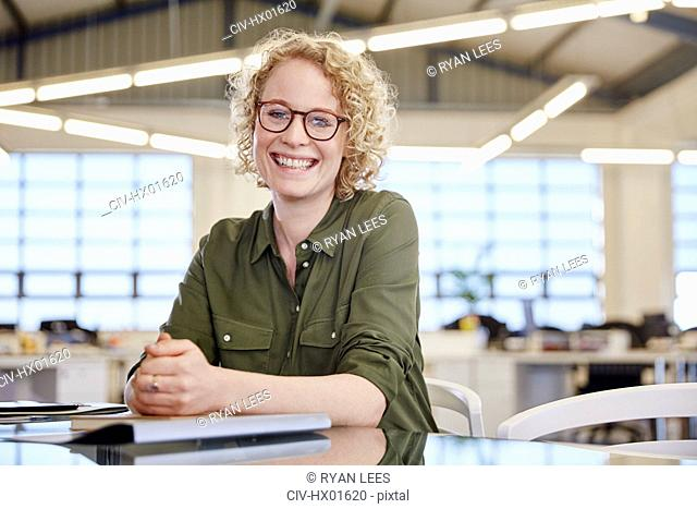 Portrait smiling businesswoman in office