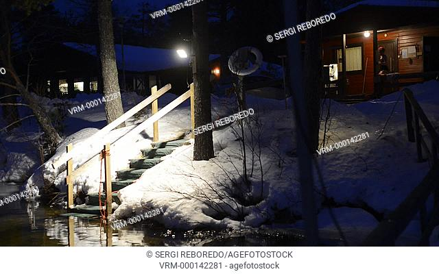 People take a sauna in a cottage next to the Kemi river, Salla, Lapland, Finland. Breath taking sauna experience. A Finnish Sauna is an important part of...
