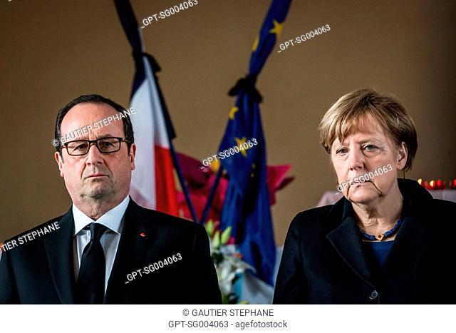 FRANCOIS HOLLANDE, PRESIDENT OF FRANCE, AND THE GERMAN CHANCELER ANGELA MERKEL PAYING RESPECTS AT THE MORTUARY FOLLOWING THE CRASH OF GERMANWINGS AIRLINE'S...