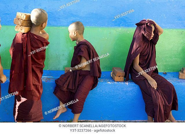 Myanmar (formerly Burma). Kyaiktiyo. State Mon. Sacred site of the golden rock. Young monks