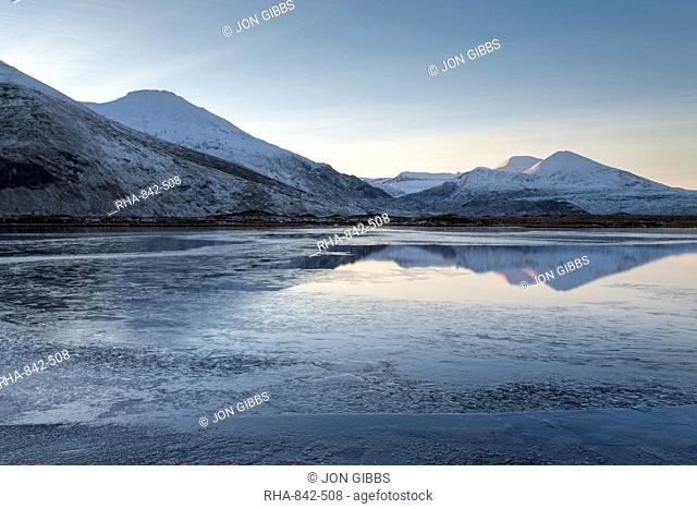 A view of the mountains of Cranstackie and Foinaven from a small lochan near Carbreck, Sutherland, Scotland, United Kingdom, Europe