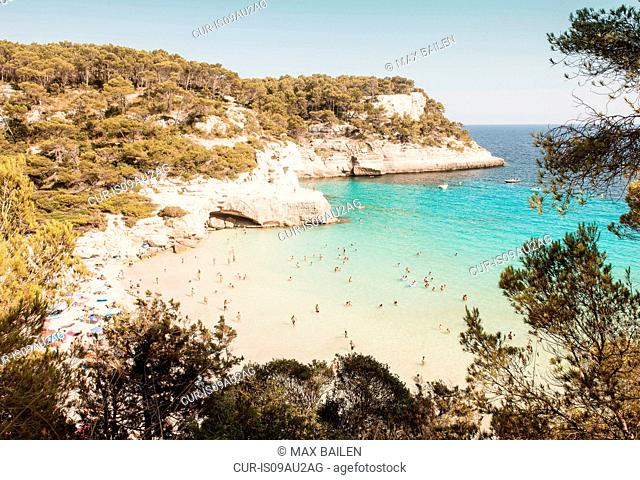 High angle view of tourists at beach, Cala Galdana, Menorca, Balearic Islands, Spain
