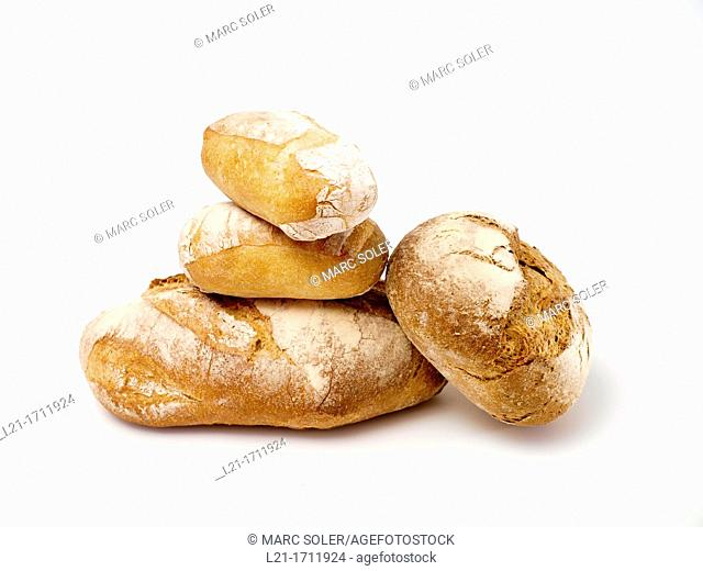 Four loaves of bread, one over the other, on white background