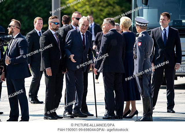 01 September 2019, Poland, Warschau: Czech President Milos Zeman (M) is welcomed by Polish President Andrzej Duda (4th from right) and his wife Agata...