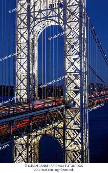 George Washington Bridge GWB - Close up of the New Jersey NJ side completely illuminated stanchion with car lights streaking thru the George Washington Bridge...