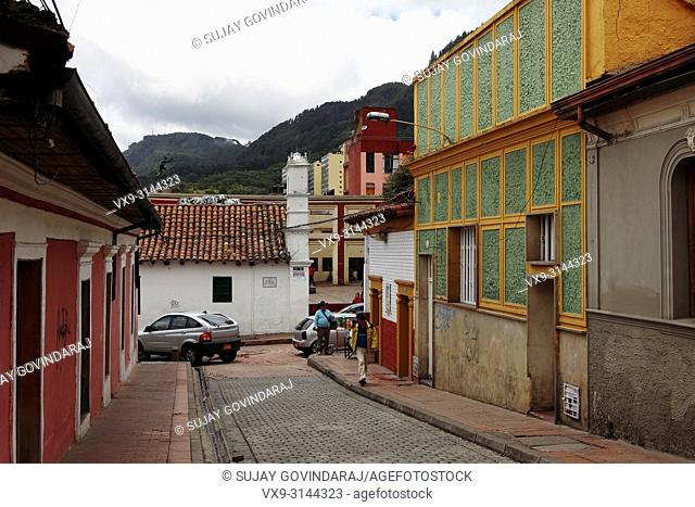 Bogota, Colombia - July 20, 2016: Looking down one of the streets in the La Candelaria District that leads to the Plaza del Chorro de Quevedo