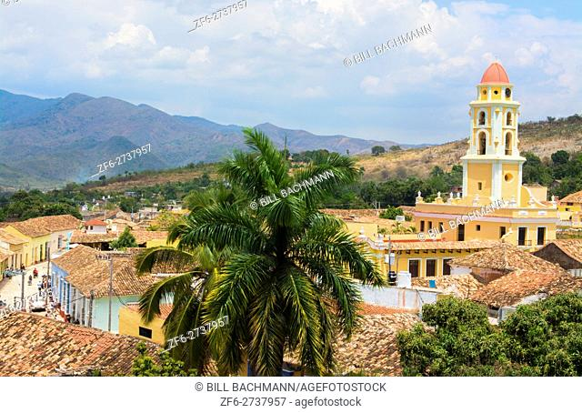 Trinidad Cuba from above tower with church and mountains with buildings of tile roofs of second oldest Colonial city