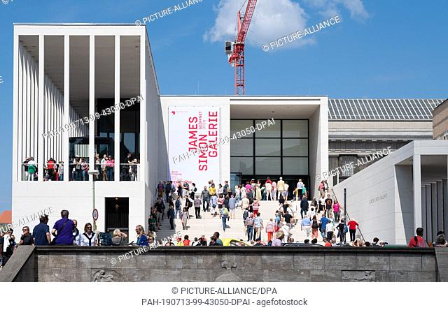 13 July 2019, Berlin: After the opening of the James Simon Gallery, visitors go up the stairs or stand on the terrace. The National Museums have invited to the...