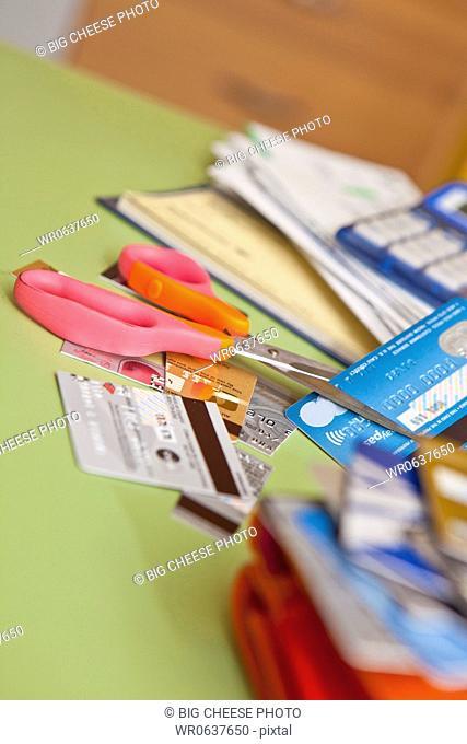 Scissors cutting up credit cards