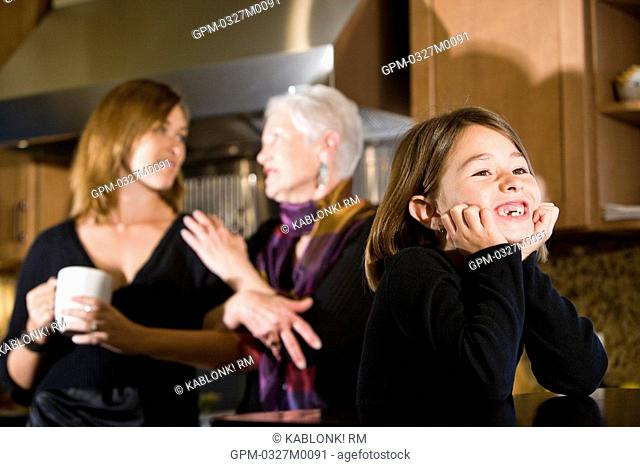 Multi-generational family in kitchen at home