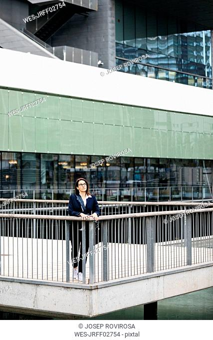 Businesswoman standing outside office building in the city
