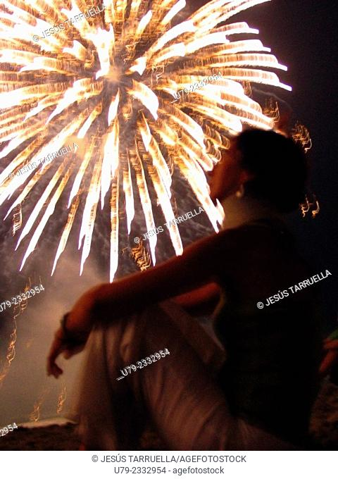 Woman in display fireworks show