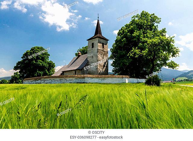 View of a gothic church in Ludrova village near Ruzomberok in Slovakia, summer 2015