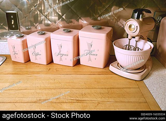 Kitchen mixer and canisters on a counter top in a kitchen