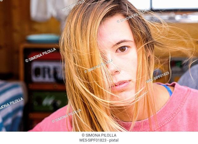 Spain, Tenerife, portrait of young woman in van