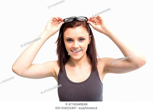 Cheerful sexy woman wearing glasses posing on white background