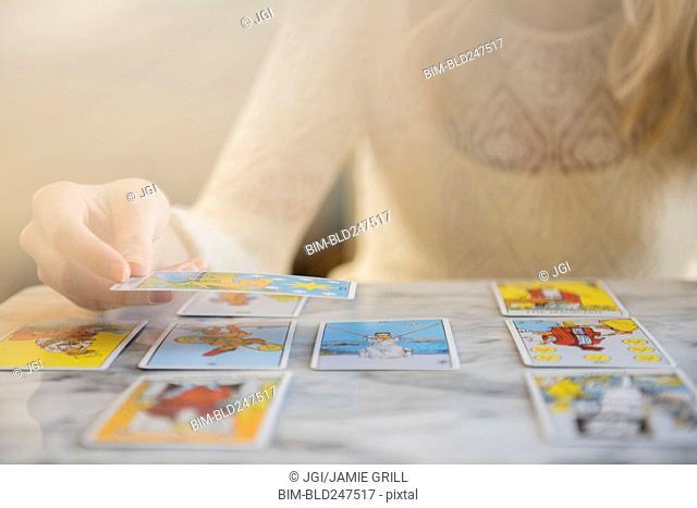 Caucasian woman using tarot cards