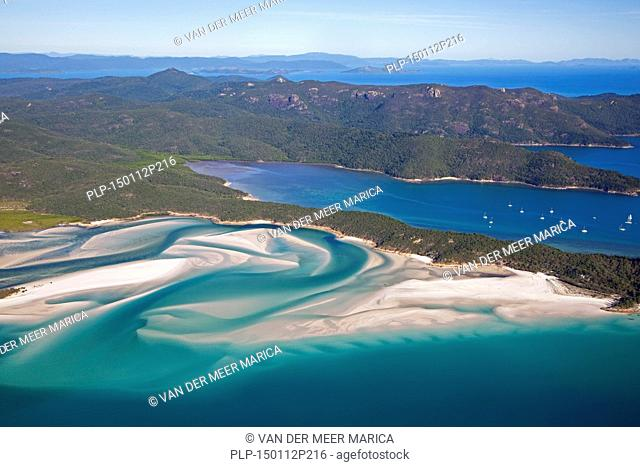 Areal view of white sandy beaches and turquoise blue water of Whitehaven Beach on Whitsunday Island in the Coral Sea, Queensland, Australia