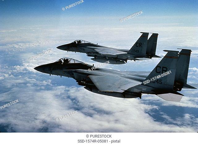 Two F-15 Eagle jet fighters in flight