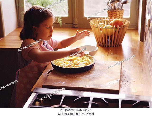 Child preparing pie